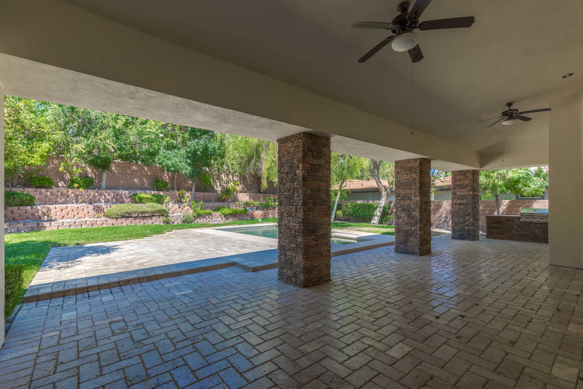 covered patio and yard